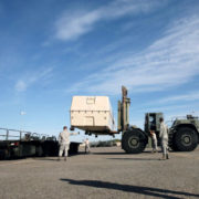 "John ""Buck"" Buchanan, front right, watches as members of the 60th Aerial Port Squadron use a forklift to load a piece of cargo on Tuesday at Travis Air Force Base. Buchanan has been a mentor for and part of the 60th Aerial Port Squadron since the 1990's. (Aaron Rosenblatt/Daily Republic)"